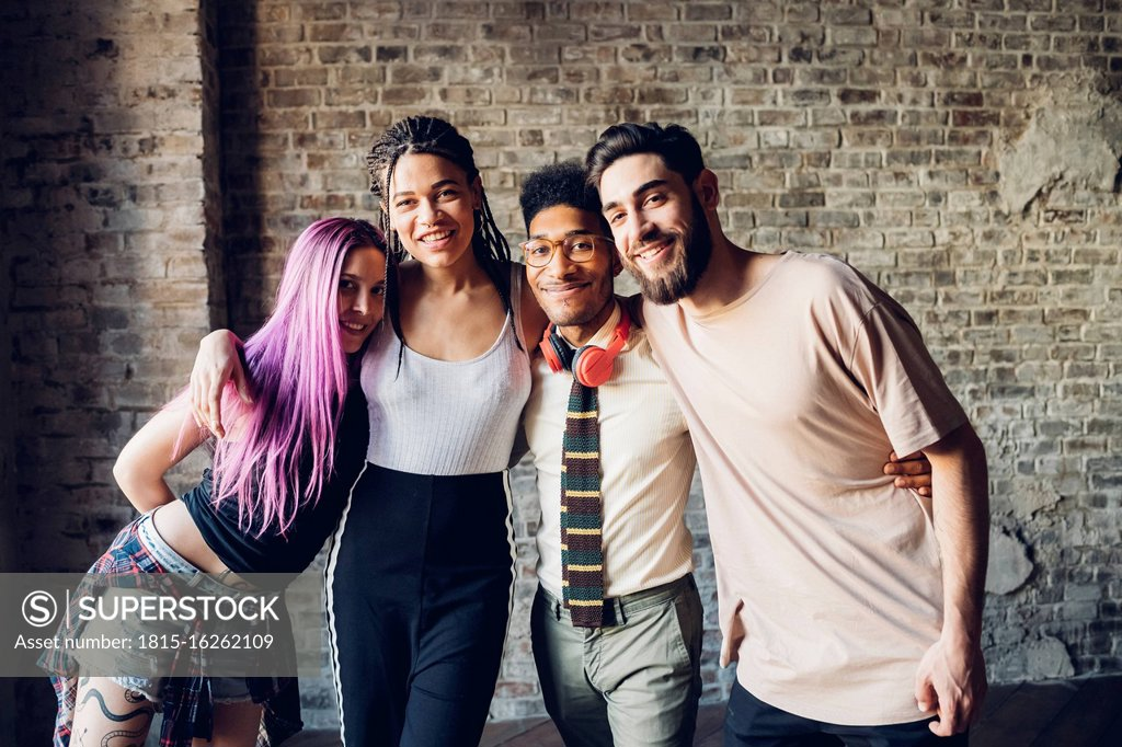 Stock Photo: 1815-16262109 Portrait of happy group of friends in a loft