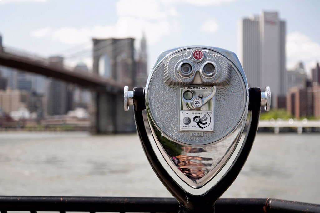 Stock Photo: 1815-105409 USA, New York City, Coin operated Binoculars in foreground of city