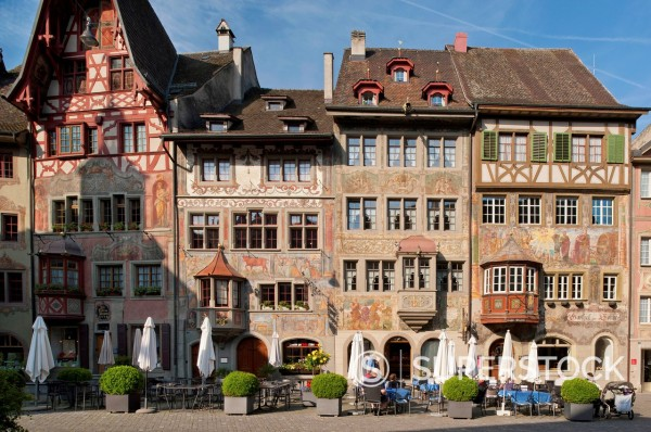 Switzerland, Stein am Rhein, People on pavement cafe and historic houses : Stock Photo