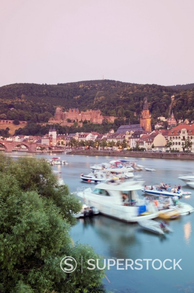 Stock Photo: 1815-105542 Germany, Heidelberg, People in boat on Neckar River with castle in background