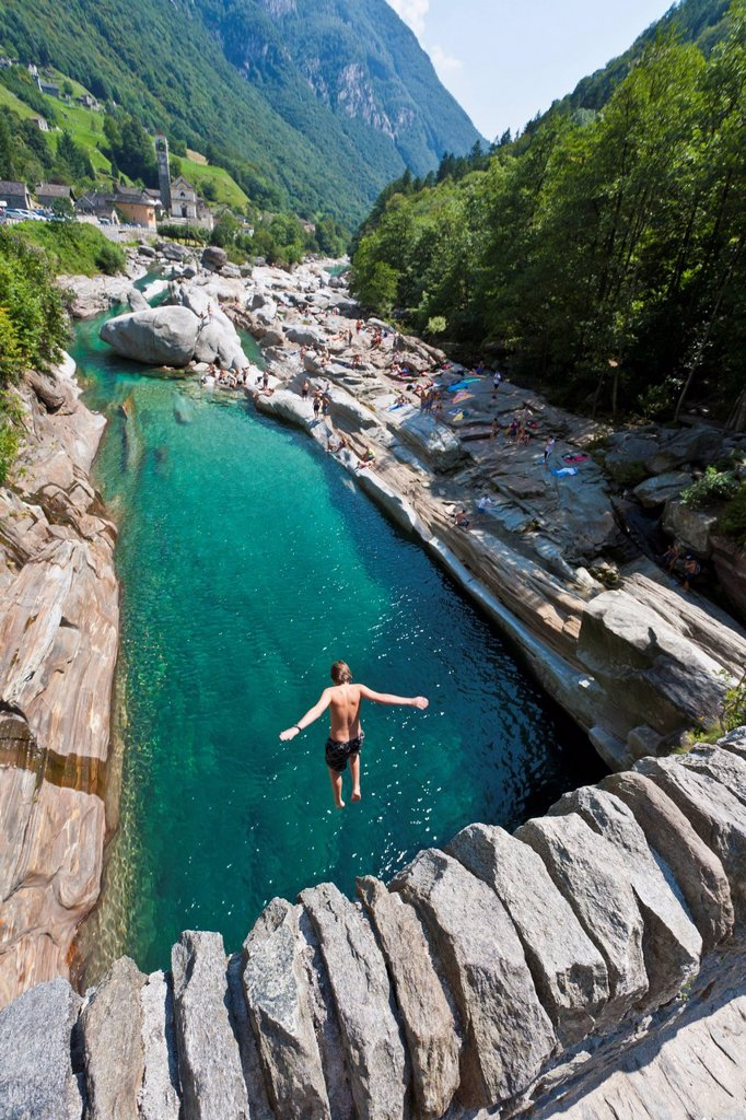 Switzerland, Ticino, Boy jumping into river : Stock Photo