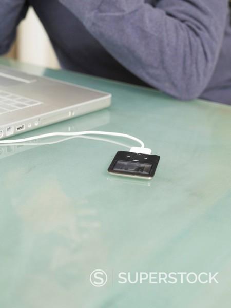 Germany, Munich, Laptop and ipod besides senior man : Stock Photo