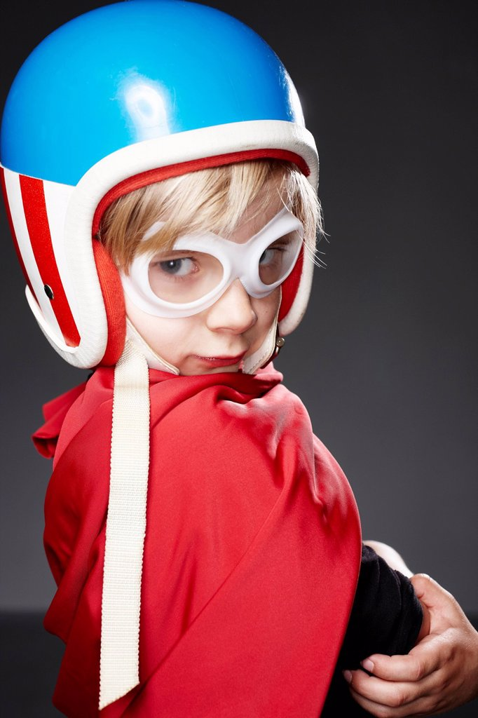 Stock Photo: 1815-127388 Portrait of boy with racer helmet, close up