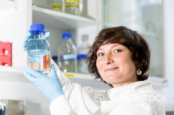 Germany, Munich, Scienist evaluating samples : Stock Photo