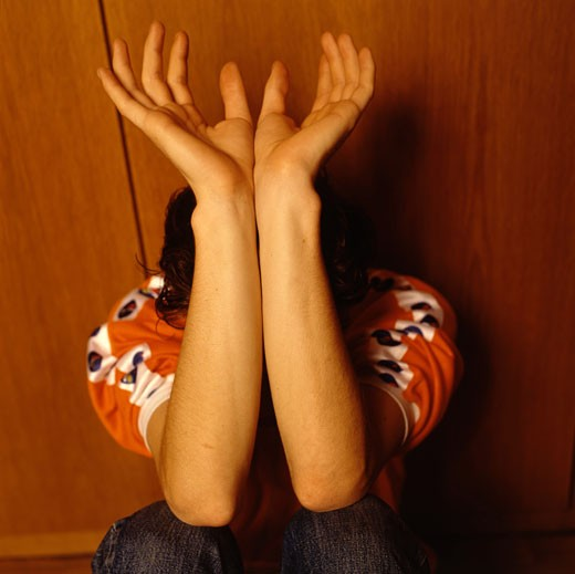 Stock Photo: 1815-38102 Young man crouching