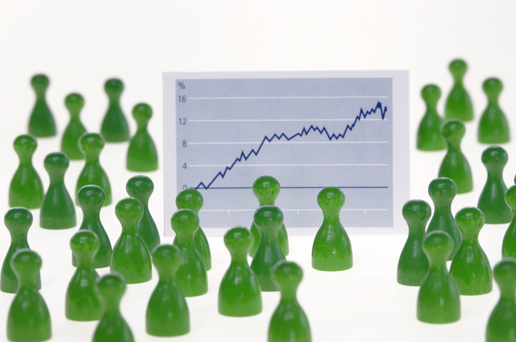 Game pieces in front of graph, close-up : Stock Photo