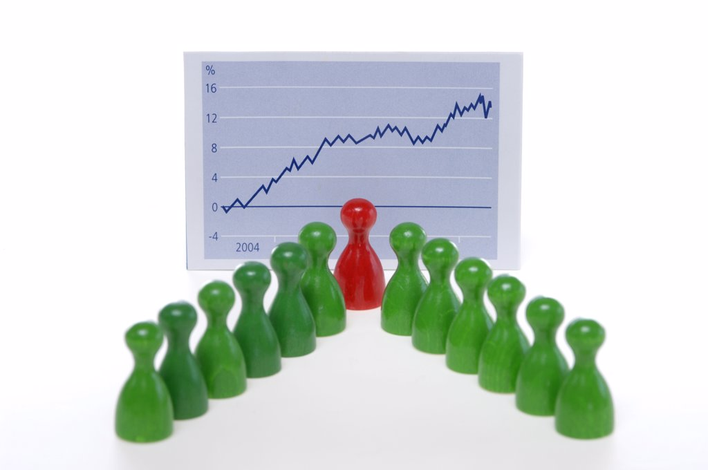 Stock Photo: 1815-39910 Game pieces in front of graph, close-up