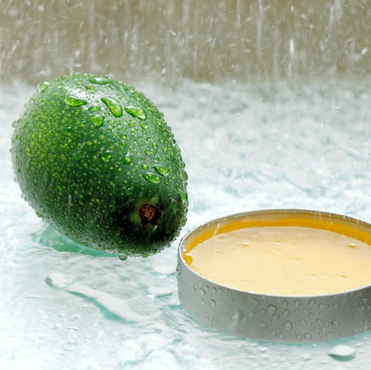 Avocado and honey, close-up : Stock Photo