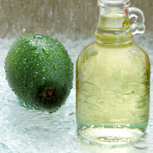 Stock Photo: 1815-40224 Avocado and soy bean oil in glass bottle, close-up