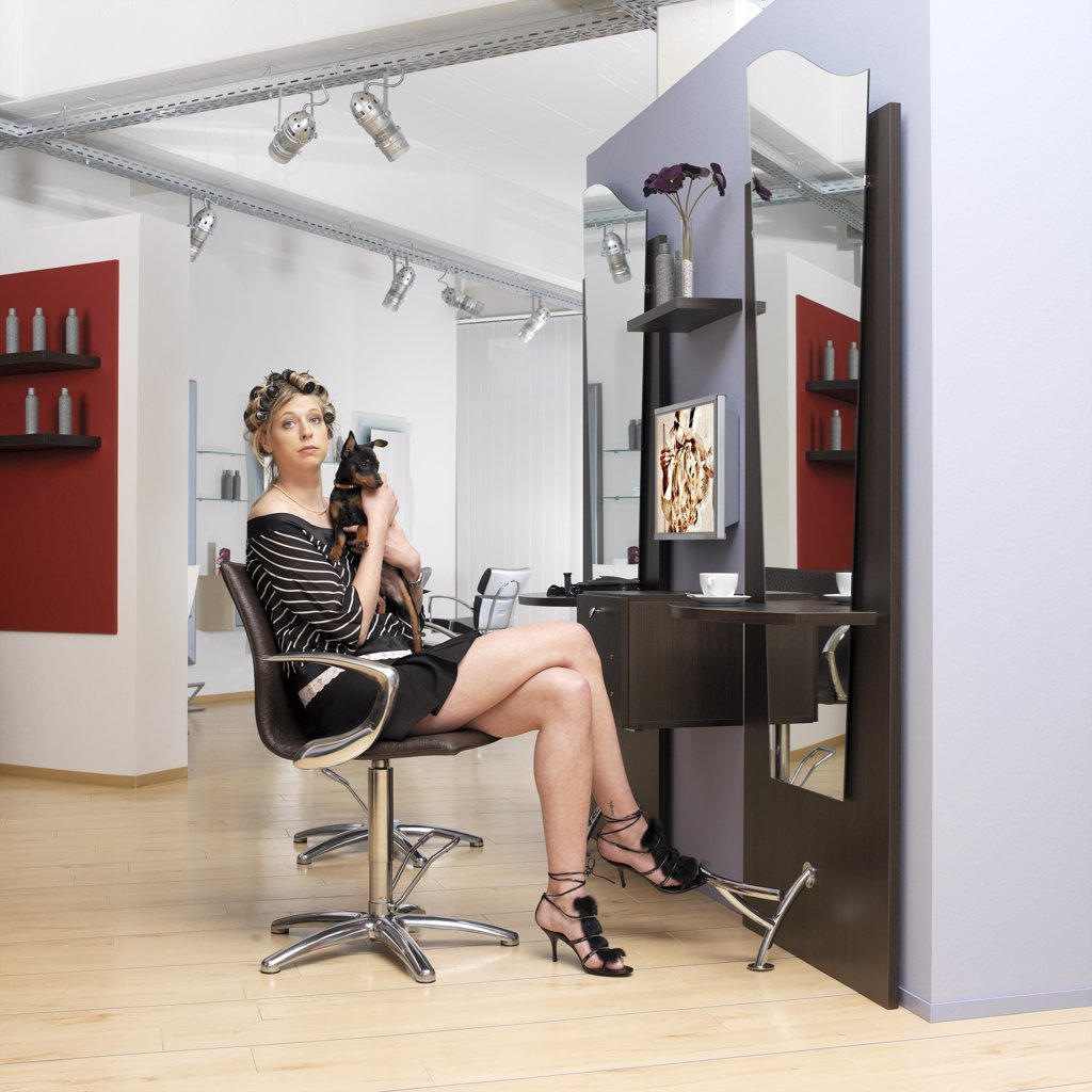 Stock Photo: 1815-41700 Woman holding dog at hairdresser