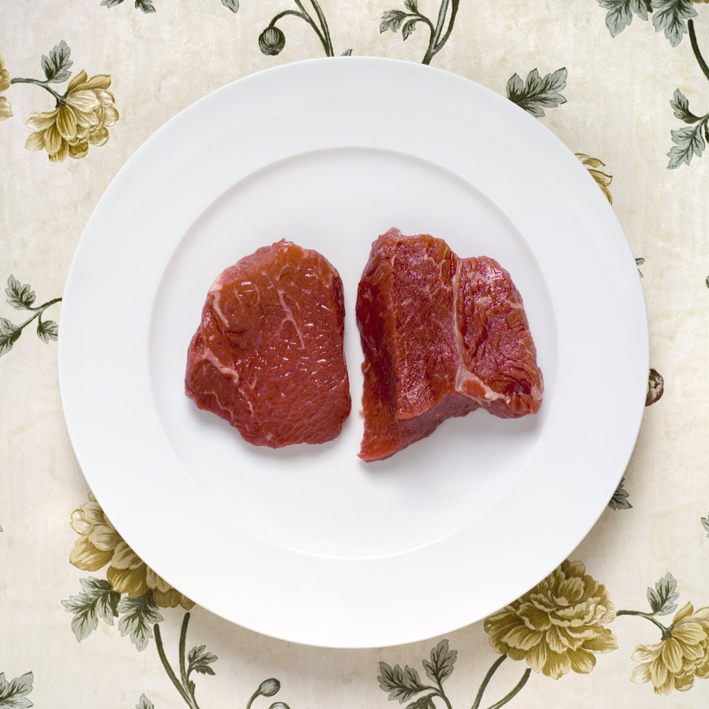 Raw steak, elevated view : Stock Photo