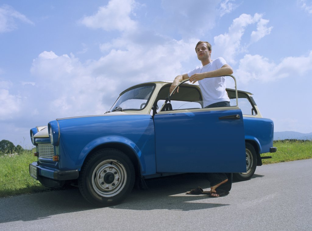 Man with car : Stock Photo