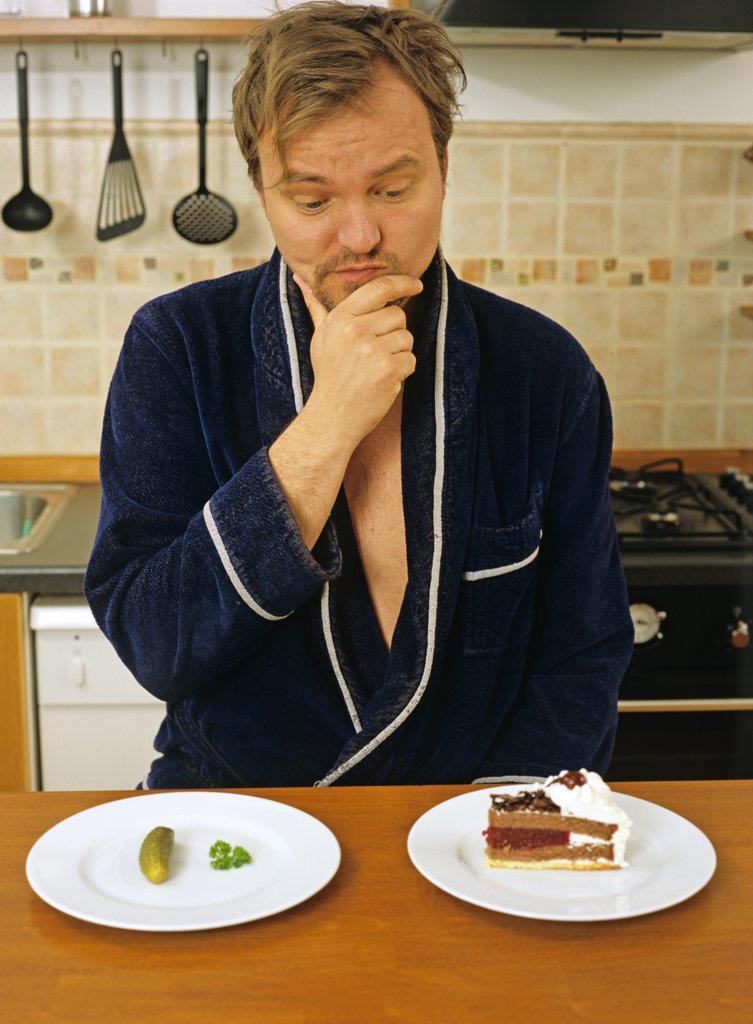 Stock Photo: 1815-43376 man deciding what to eat