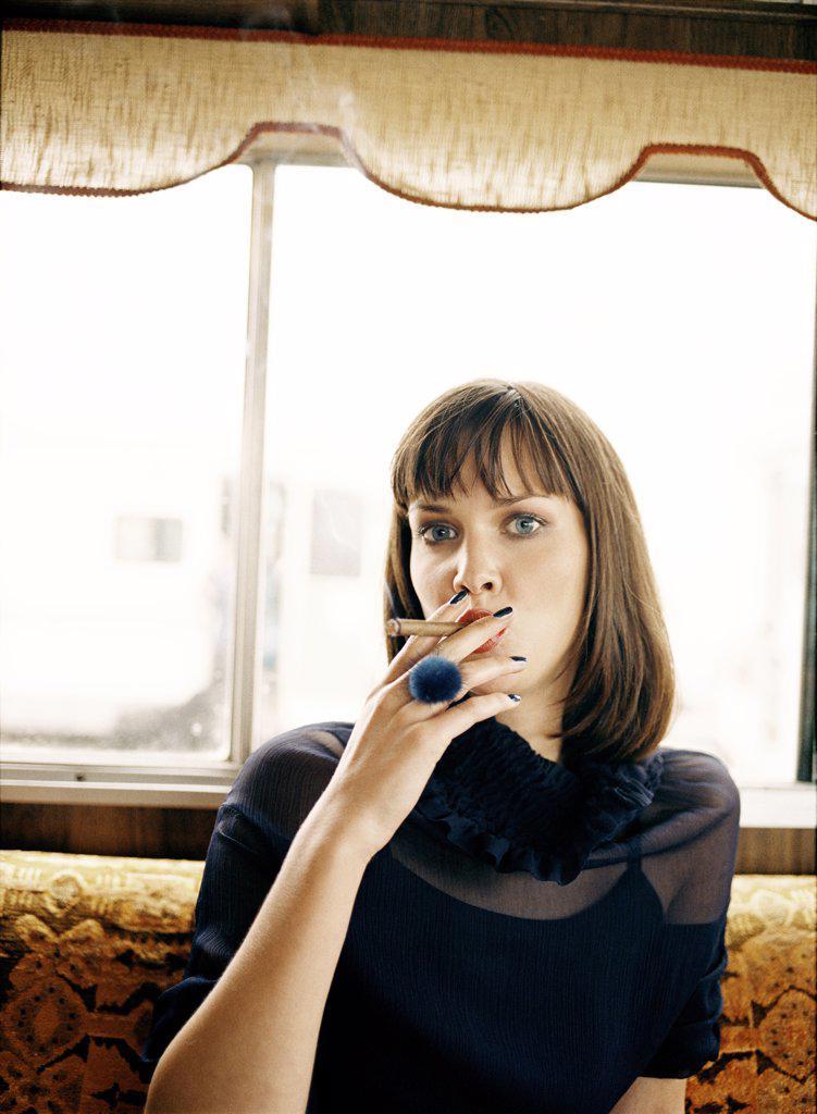 Woman smoking cigar, portrait : Stock Photo