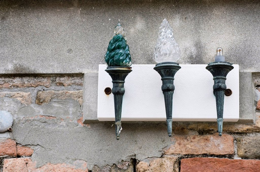 Italy, Venice, Glass lanterns on house facade : Stock Photo
