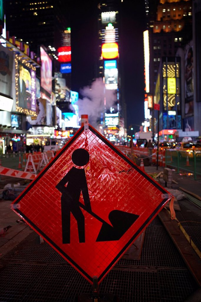 Stock Photo: 1815-49504 USA, New York City, Manhattan, Work in progress sign in foreground, Times Square at night