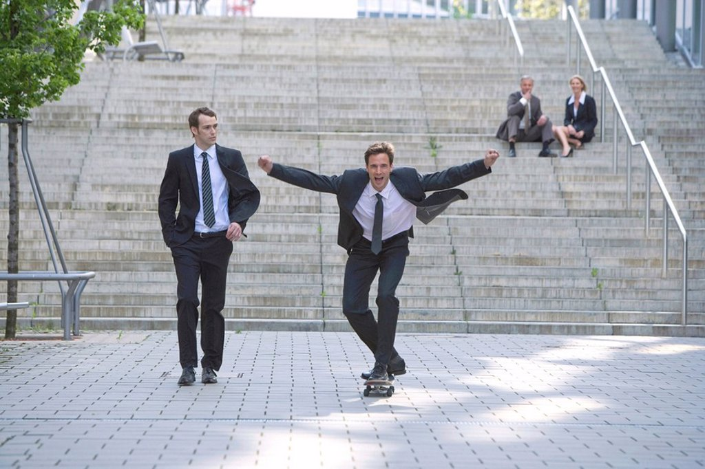 Stock Photo: 1815-49636 Germany, Baden_Württemberg, Stuttgart, Businesspeople fooling around