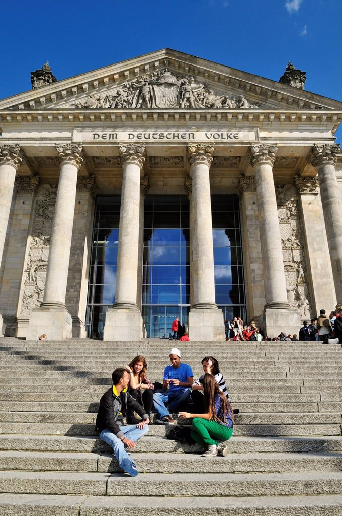 Europe, Germany, Berlin, Reichstag, View of people sitting in front of german parliament : Stock Photo