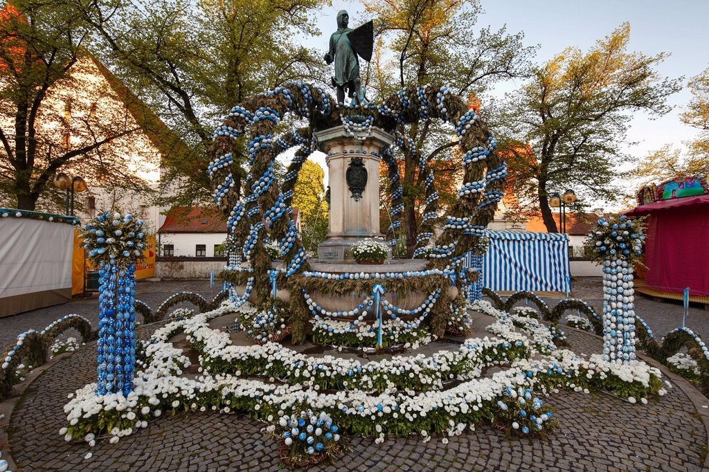 Germany, Bavaria, Upper Bavaria, Ingolstadt, Paradeplatz, View of fountain and statue decorated with easter eggs : Stock Photo