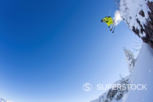 Austria, Tyrol, Kitzbuhel, Mid adult man skiing : Stock Photo