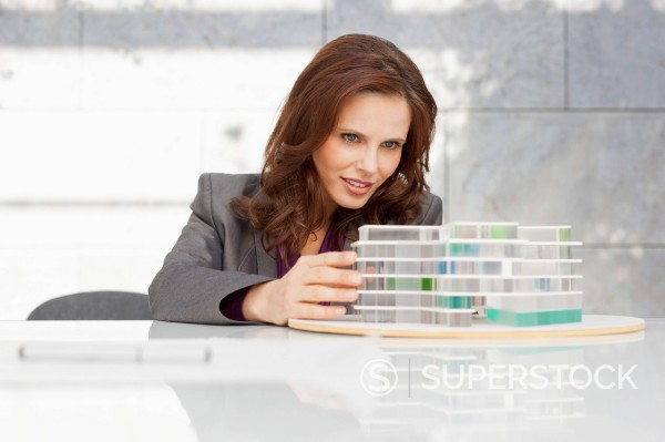 Germany, Leipzig, Businesswoman looking at architectural model : Stock Photo