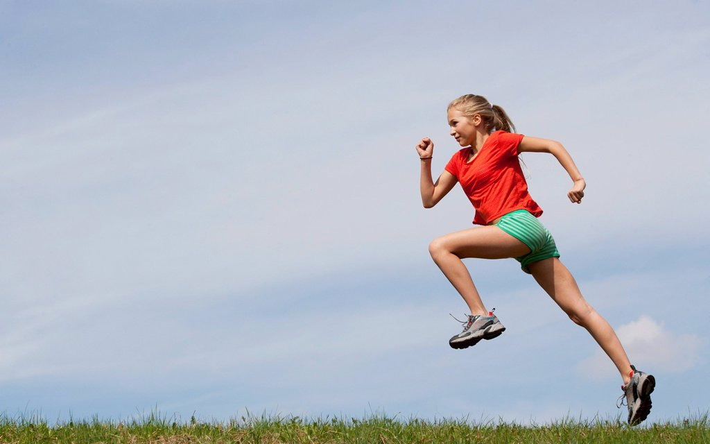 Stock Photo: 1815R-101224 Austria, Teenage girl running on grass