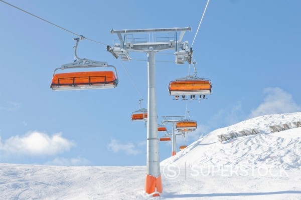 Austria, View of ski lift above austrian alps : Stock Photo
