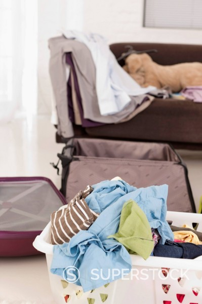 Germany, Leipzig, Unpacked suitcase in apartment : Stock Photo