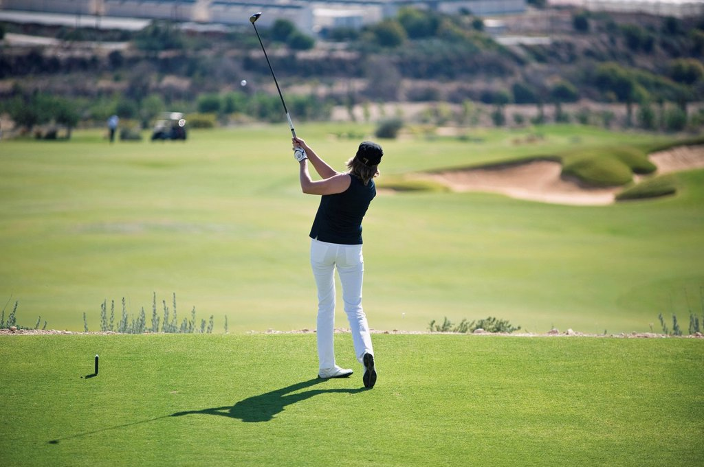 Stock Photo: 1815R-101657 Cyprus, Woman playing golf on golf course