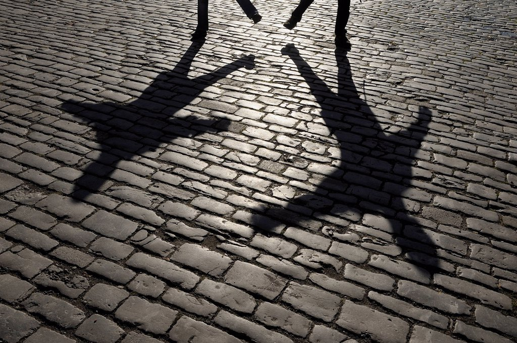 Stock Photo: 1815R-103019 Germany, Bavaria, Rothenburg ob der Tauber, Shadow of people on cobblestone