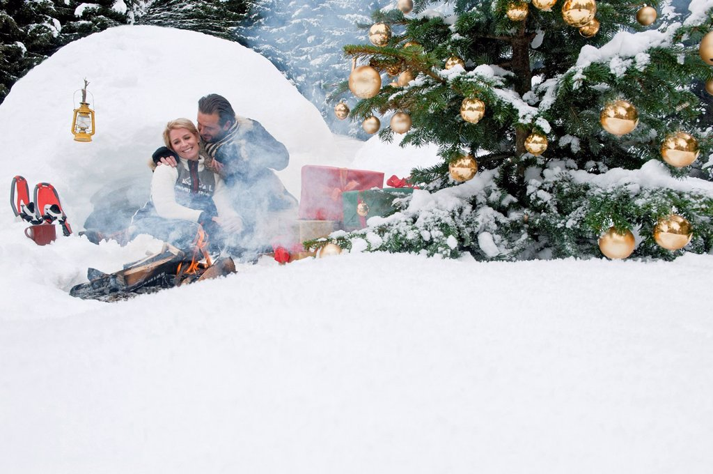 Austria, Salzburg County, Couple celebrating christmas in nature, smiling : Stock Photo
