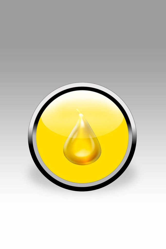 Yellow button showing drop of oil, close up : Stock Photo