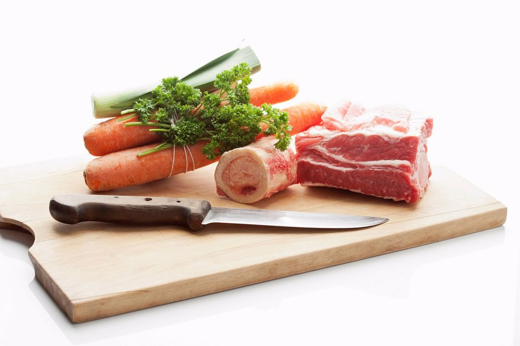 Stock Photo: 1815R-105155 Beef broth ingredients on chopping board, close up