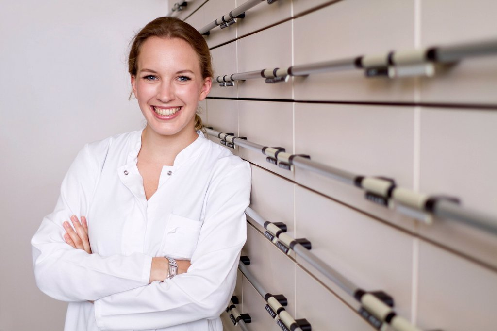 Germany, Brandenburg, Pharmacist smiling, portrait : Stock Photo