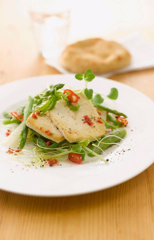 Stock Photo: 1815R-108609 Asparagus salad and roasted tofu garnished with chili on plate