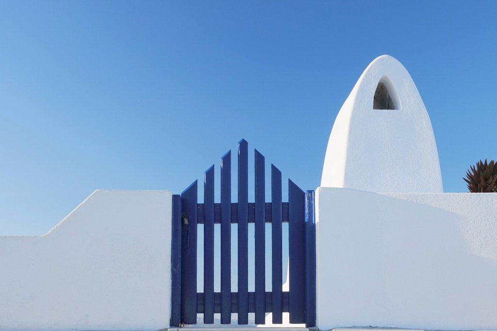 Stock Photo: 1815R-109221 Greece, Traditionally Greek gate and chimney in oia village at Santorini