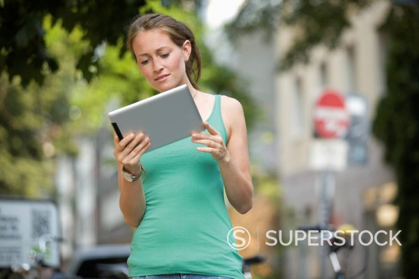 Stock Photo: 1815R-109390 Germany, North Rhine Westphalia, Cologne, Young woman with digital tablet