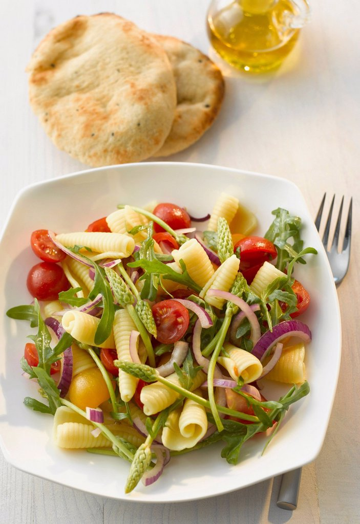 Plate of campanelle salad with wild asparagus and naan on table : Stock Photo