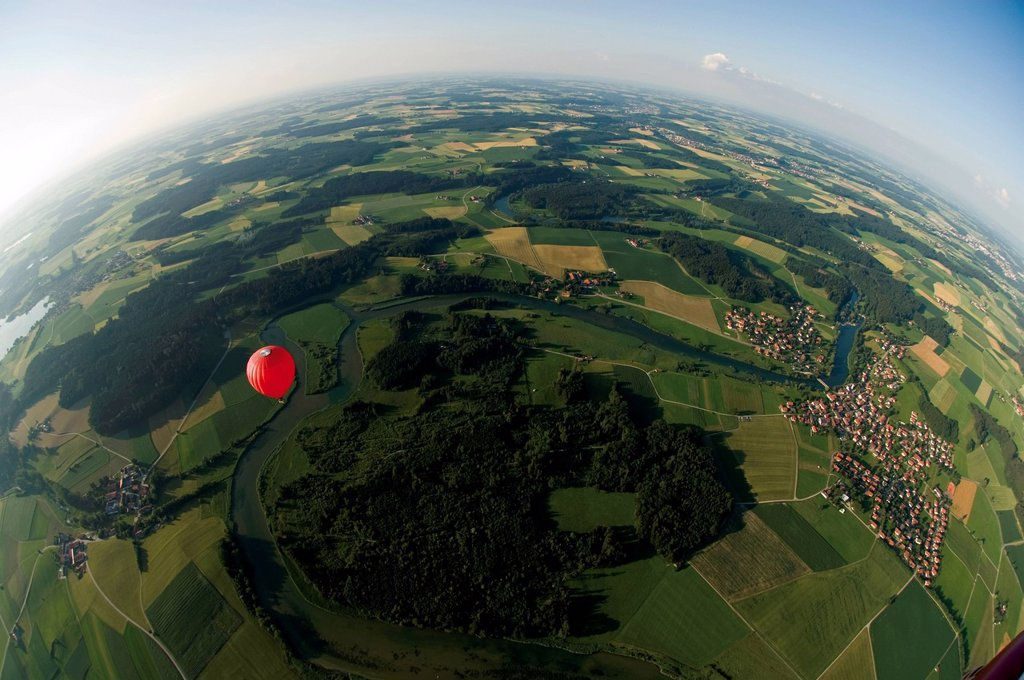 Germany, Bavaria, View of hot air balloon over pasture landscape : Stock Photo