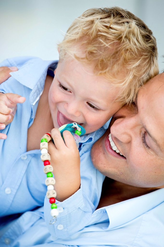 Germany, Father carrying son, smiling : Stock Photo
