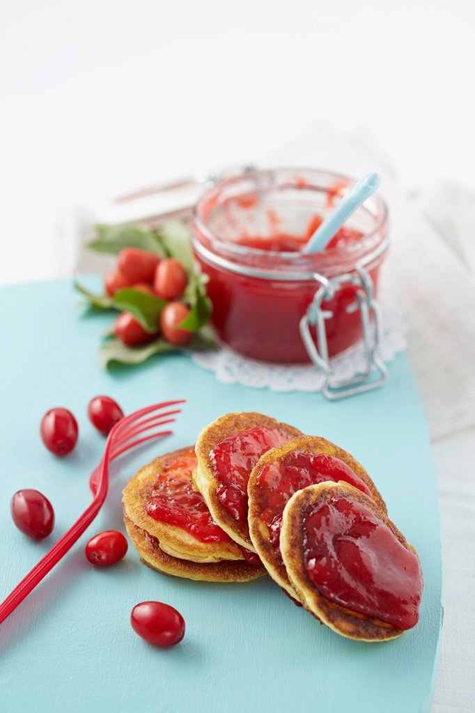 Stock Photo: 1815R-113319 Cornel cherry jam with pancakes on chopping board