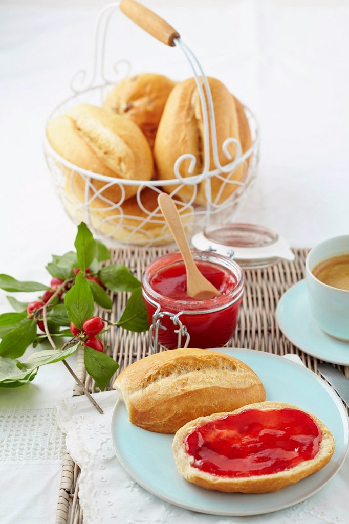 Stock Photo: 1815R-113323 Cornel cherry jam with bread rolls and coffee on table