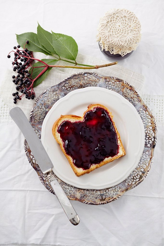 Elderberry jam with white bread on plate : Stock Photo