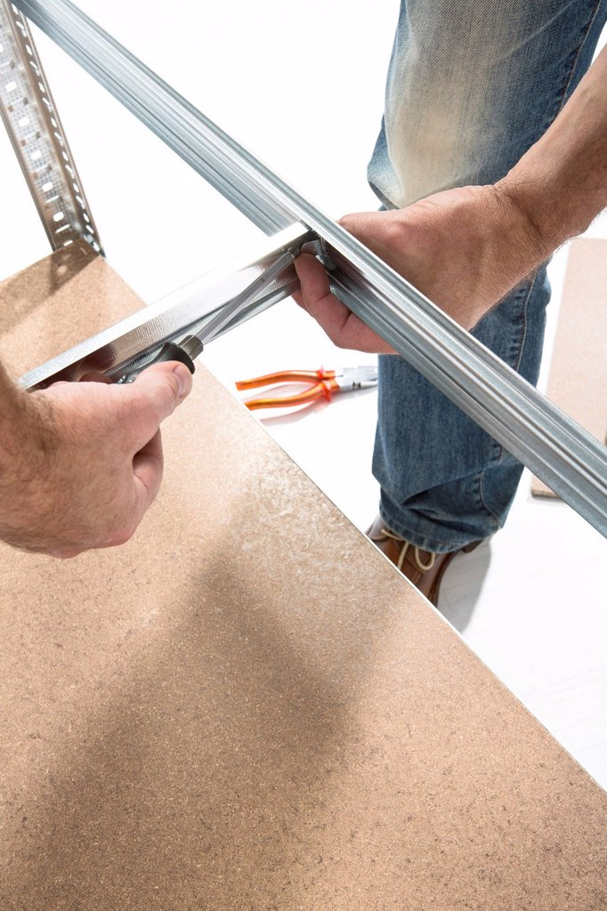 Stock Photo: 1815R-113498 Mature man building shelf