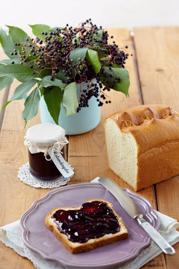 Stock Photo: 1815R-113939 Elderberry jam with white bread on wooden table