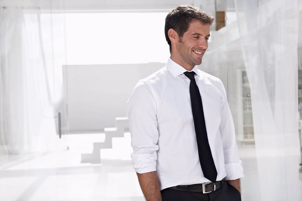 Stock Photo: 1815R-114182 Spain, Businessman looking away, smiling