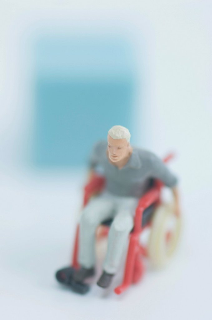 Figurine in wheelchair : Stock Photo