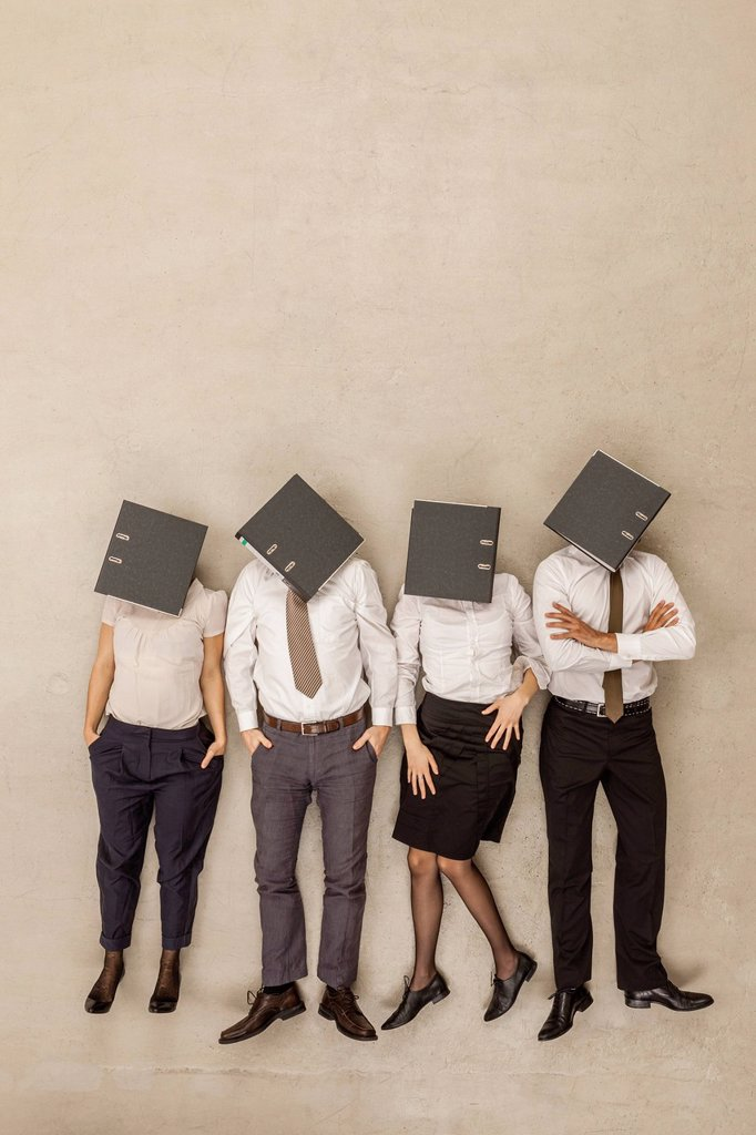 Business people with covered head by folders : Stock Photo