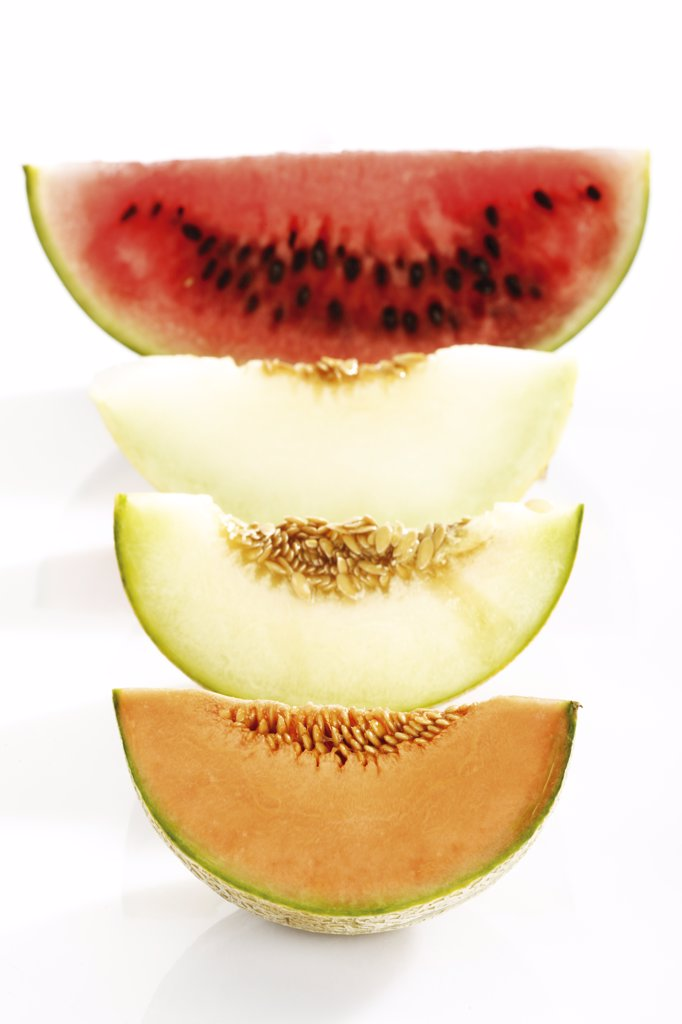 Various sliced melons, elevated view : Stock Photo