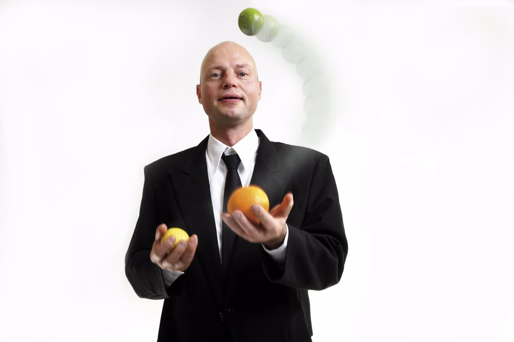Business man juggling with balls : Stock Photo